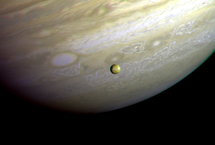 Jupiter and Io photographed by the Voyager 2 probe on 9 July 1979.